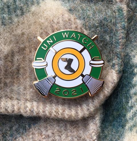 Uni Watch Pin Club: January 2021 Standard T-Shirt Front