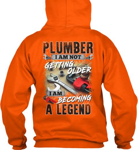 Plumber I Am Not Getting Older I Am Becoming A Legend Safety Orange T-Shirt Back